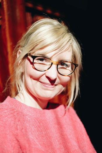 Close-up portrait of smiling woman wearing eyeglasses