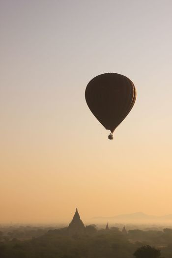 Bucketlist Temples Of Bagan Adventure Architecture Bagan Clear Sky Flying Hot Air Balloon Mid-air Nature No People Outdoors Scenics Silhouette Sky Sunrise