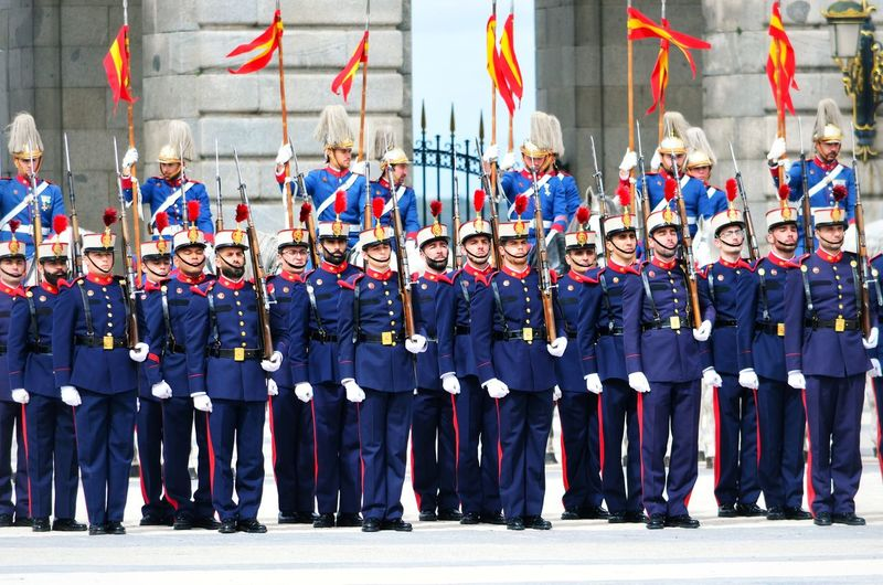 Changing of the Guard, Madrid, Spain Madrid Madrid Spain SPAIN Spaın Tourism Tourist Attraction  Tourist Destination Royal Palace Guard Changing Of The Guard Spectacle Ceremony Royal Guard Solemn Changing First Wednesday Military Band Procession Row Weapon On The Shoulders Spearmen Halberdier Rifle Account Ammunition Horses Tradition Palace Drummer Performing CalleBailen Large Group Of People Group Of People Crowd Uniform Men Pride Government Parade Real People Military Uniform Patriotism Clothing Celebration Togetherness Cooperation Front View Teamwork Flag Outdoors