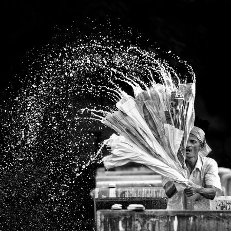 Capture The Moment A dhobi washing clothes. Dhobi Washing Clothes Backlight Water Sprinkle Chennai Monochrome Photography Welcome To Black