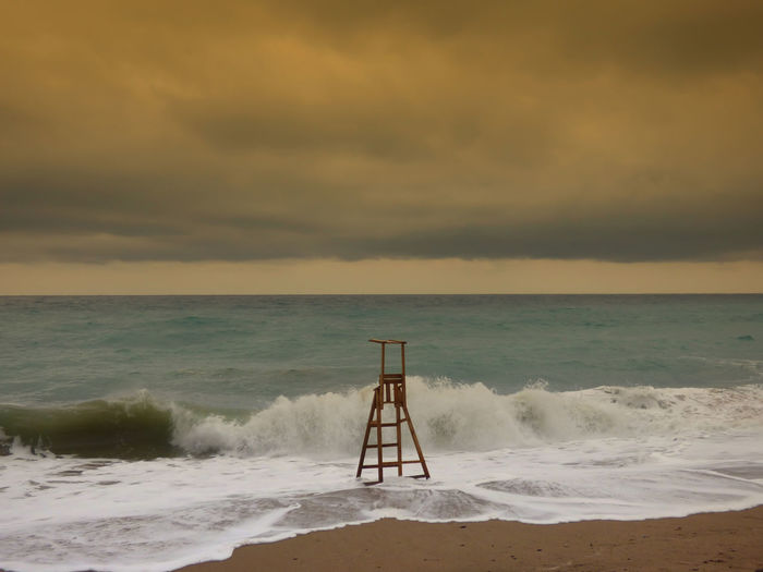 Beach Beach Photography Beauty In Nature Cloud Cloud - Sky Horizon Over Water Lifeguard Watchtower Nature Non-urban Scene Remote Scenics Sea Seascape Shore Sky Storm Cloud Tranquil Scene Tranquility Water