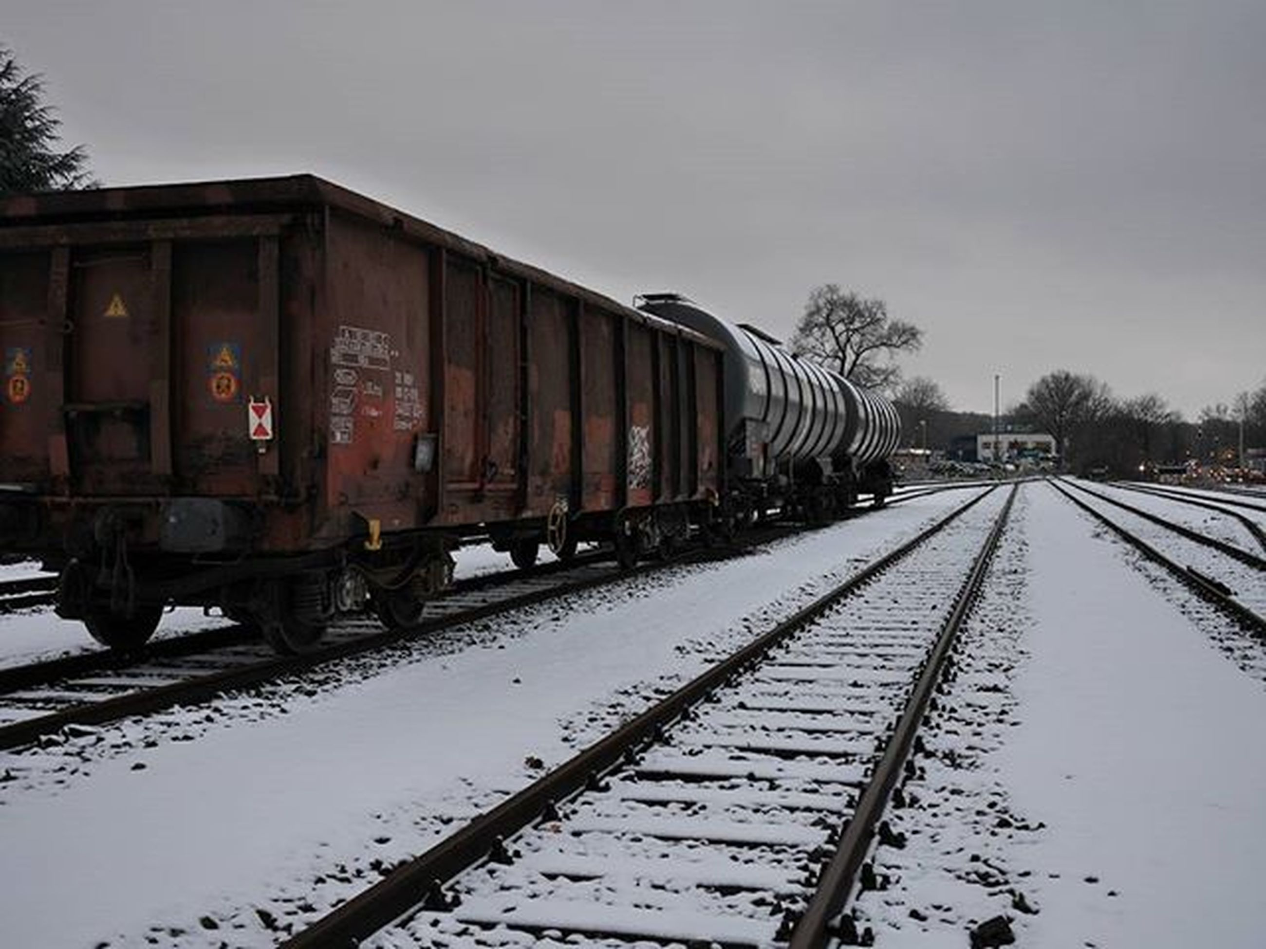 transportation, built structure, architecture, building exterior, sky, winter, mode of transport, cold temperature, season, snow, weather, the way forward, diminishing perspective, railroad track, in a row, outdoors, street, no people, day, land vehicle