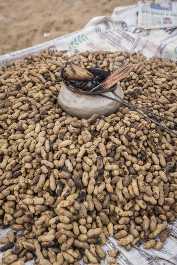 roasted peanuts in indian style on peanut stall in Pushkar, India Close-up Focus On Foreground Food India Travel Indian Style Indianstories Indiapictures Nut Outdoors Peanuts Photowalk Pile Retail  Roasted Peanuts Selective Focus Traditional Travel Photography
