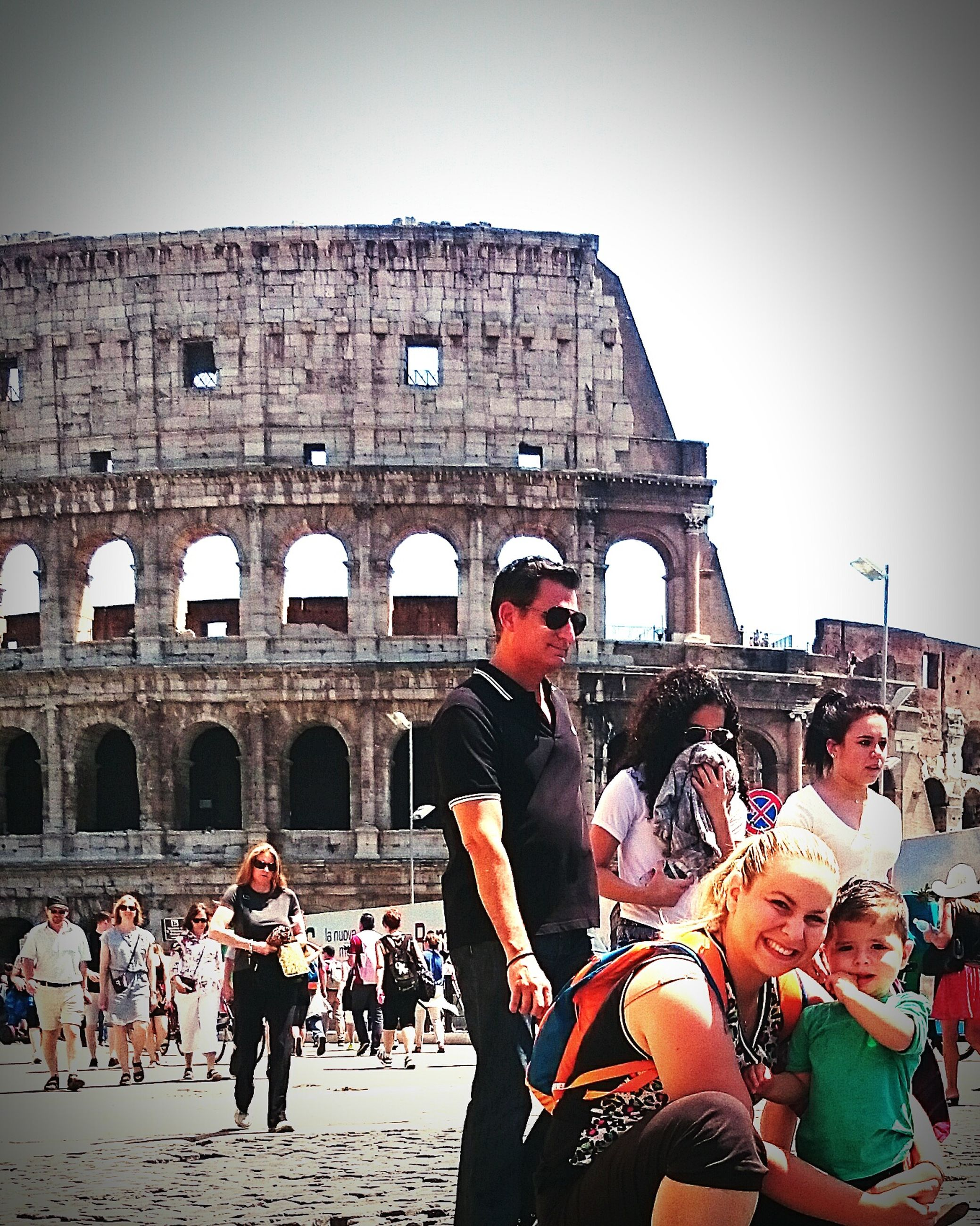 lifestyles, leisure activity, architecture, large group of people, built structure, building exterior, tourism, casual clothing, young adult, person, tourist, togetherness, young women, vacations, men, famous place, travel destinations