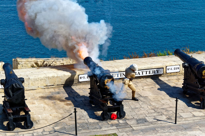 High angle view of military officer escaping from fire at saluting battery