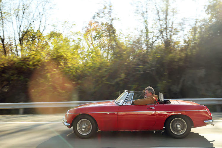 Car Classic Cars Landscape Lifestyle On The Road Outdoors Red Car Roadster The Old Couple Weather