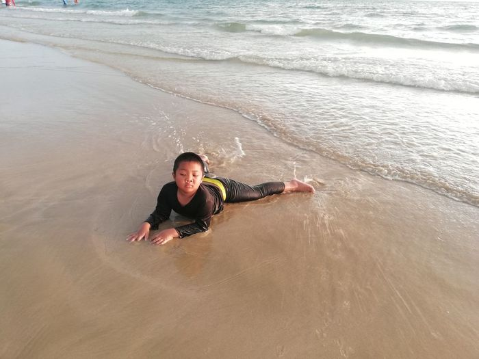 Children enjoy on summer trip 2019,หาดเจ้าหลาว Achi2019 Sea Beach Water Land One Person Lifestyles Leisure Activity Wave Real People Motion High Angle View Weekend Activities Portrait Aquatic Sport Enjoyment Nature Vacations Trip Outdoors Boy
