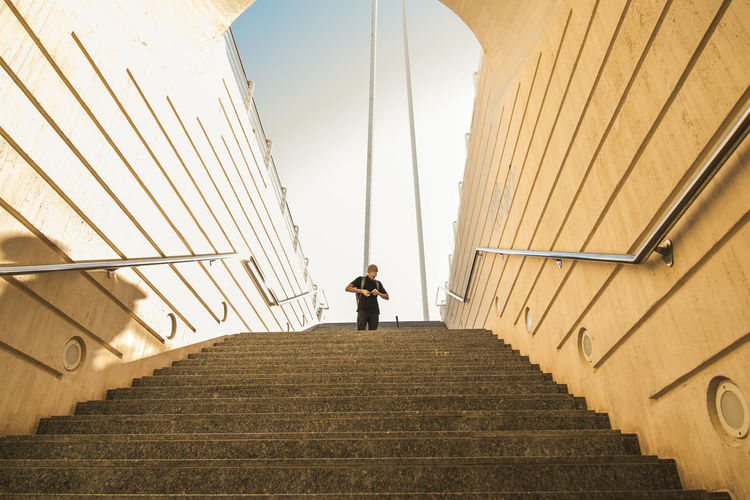 Low angle view of man standing on staircase
