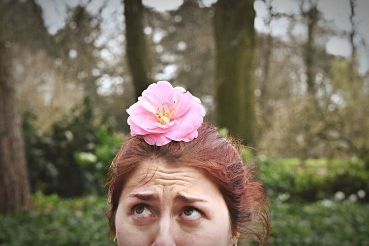 High section of woman with flower on head