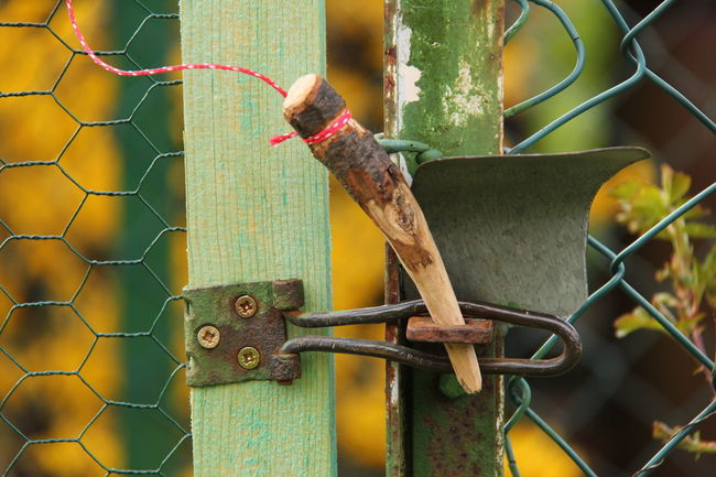 A crafted piece of wood replaces a metal lock EyeEmNewHere Focus On Foreground Fence Day Boundary Barrier No People Safety Security Protection Close-up Outdoors Gate Locked Lock Up Wood Craftmanship Crafted
