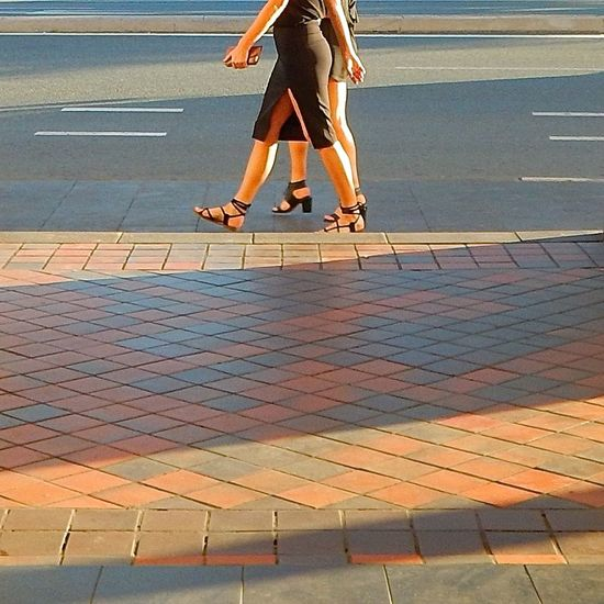 Black Dress (: City Street Footpath Footway Footwears Lines Low Angle Low Angle View Millennial Pink Only Women Outdoors Pavement Pavement Patterns Sandals Shadows Sunlight Tarmac Tile Tiles Tiles Textures Two Women Walkway