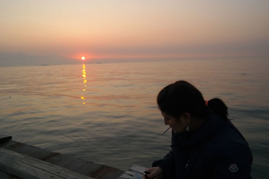 View Woman Sea Sunset Sea Water One Person Real People Nature Beauty In Nature Horizon Over Water Leisure Activity Scenics Tranquil Scene Outdoors Lifestyles Childhood Sun Boys Sky Tranquility Standing Vacations An Eye For Travel An Eye For Travel Shades Of Winter
