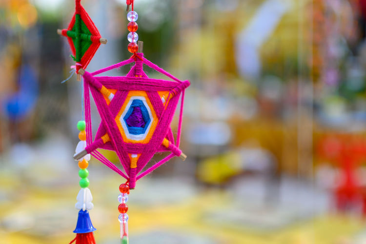 Close-up of multi colored toy hanging