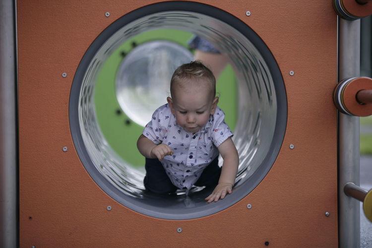 Cute boy in playground