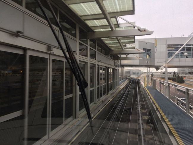 Airport Architecture Building Exterior Built Structure Cables Cars Connection Day Diminishing Perspective Metal Public Transportation Rail Transportation Railing Road Tram Transportation Vanishing Point Windshield Wipers
