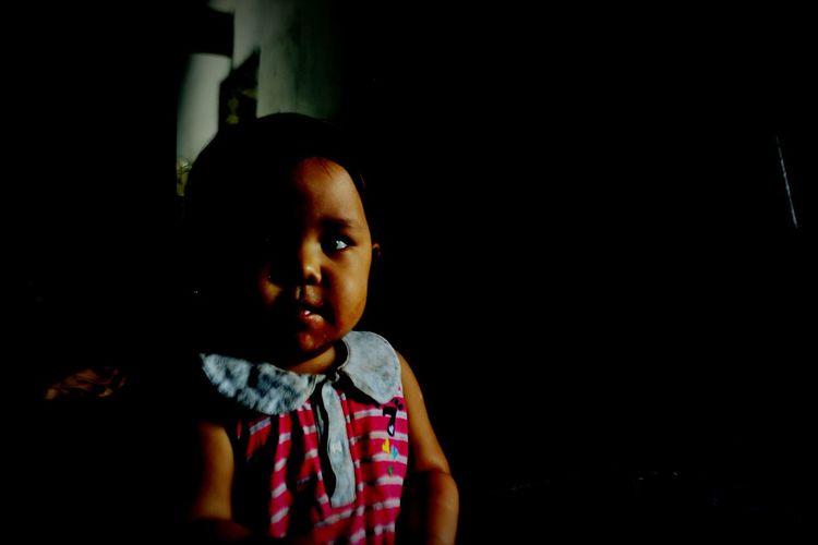 Girl looking away at night