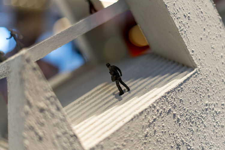 High angle view of figurine outdoors