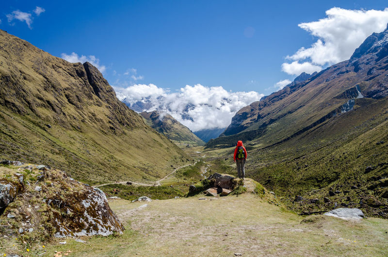 Scenic view on the Salkantay trek Adventure Backpack Beauty In Nature Hiking Hiking Mountain Mountain Range Nature One Person Outdoor Pursuit Outdoors Peru Rear View Rock - Object Salkantay Scenics Sky Trekking