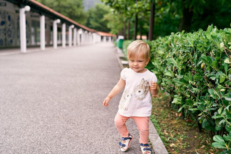 Full length of a girl walking outdoors