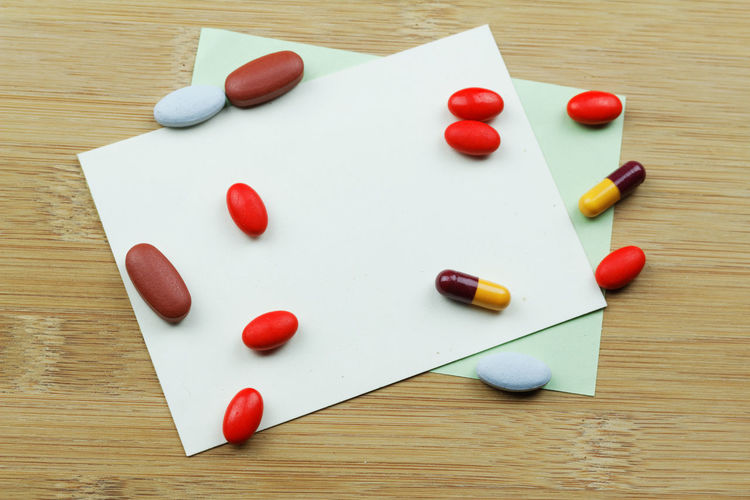 Health and medicine concept Medical Medicine Background Pill Tablet Capsule Copy Space Copyspace Wooden Background Medication Medical Medicine Red Multi Colored Wood - Material