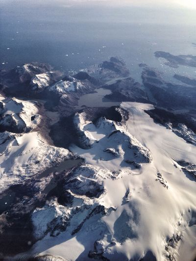 Flying over Greenland Greenland View From Above Glaciers Mountains Ice Snow View From An Airplane Remote Desolate Aerial View