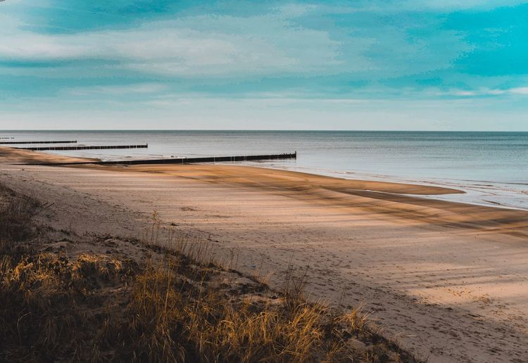 Sea Beach Horizon Over Water Water Sand Sky Scenics Nature Tranquility Beauty In Nature Tranquil Scene Shore Cloud - Sky Day Outdoors No People Blue Travel Destinations Vacations EyeEm Best Edits EyeEm Gallery The Week On Eyem EyeEm Best Shots Nikonphotography EyeEm Selects