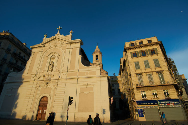 Evening at Vieux Port Marseille Architecture Streetphotography City France Sky Blue Spirituality Building Travel Tourism Evening Light Vieux Port Marseille Clear Sky Wide Angle Belief Dusk Colours Travel Destinations Low Angle View