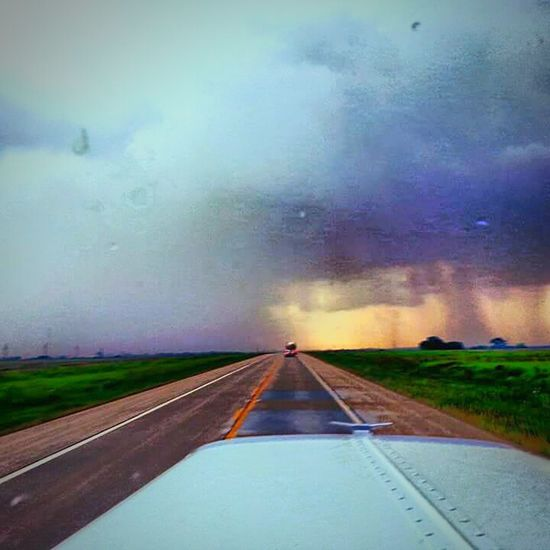 This is probably one of my favorite shots I've taken over the years. A small tornado ripping across the highway in front me. The actual twister itself is actually wrapped in rain so it made it impossible to see but the destruction was very visible when we got to it. Tornado Storm Kansas Weather Rsa_nature Rsa_rural Rsa_country Tornado Alley Truckerslife Truckers View