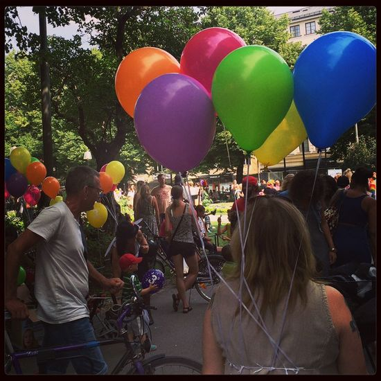 Warming up for Pride parade Strings Attached Balloons Rainbow Colors Colorful