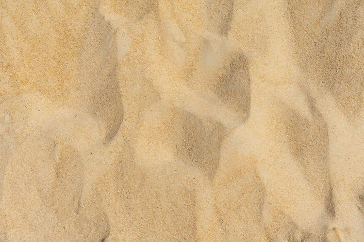 Beach sand texture. Full frame shot. Backgrounds Textured  Pattern Full Frame No People Sand Nature Close-up Beige Brown Land Outdoors Architecture Dirt Rough Day Textured Effect Concrete Built Structure Abstract The Creative - 2019 EyeEm Awards