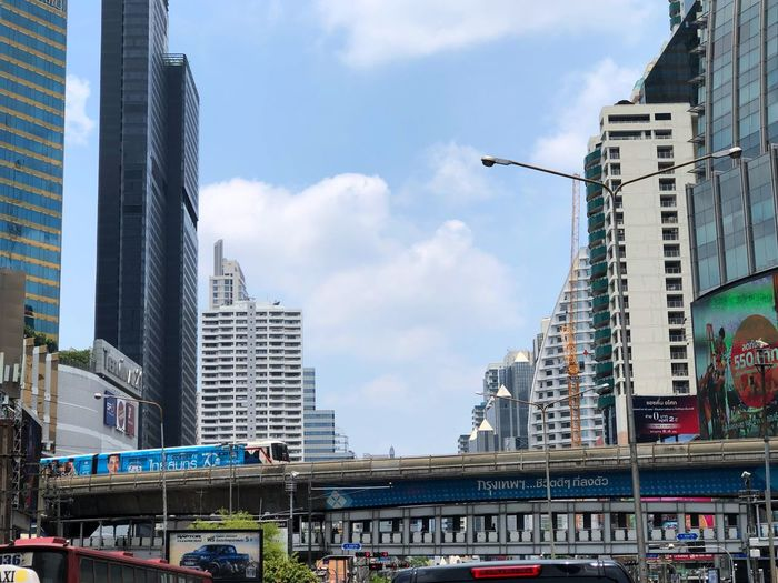 Bangkok metropolitans @ Asoke intersection on 13 April 2019 Songkran festival Architecture Built Structure Building Exterior Sky City Cloud - Sky Building Transportation Bridge Low Angle View Tower Skyscraper Office Building Exterior Nature City Life Residential District Modern Tall - High Office Day