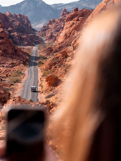 High angle view of car on road passing through desert