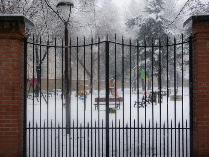 Snowfall creates a romantic winter scenary Architecture Artistic Photo Bare Tree Bench Built Structure Day Fence Metal No People Outdoors Park Playground Sky Snow Snowfall Snowy Tree Winter Winterscapes
