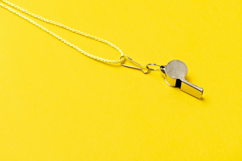 High angle view of chain on table against yellow background