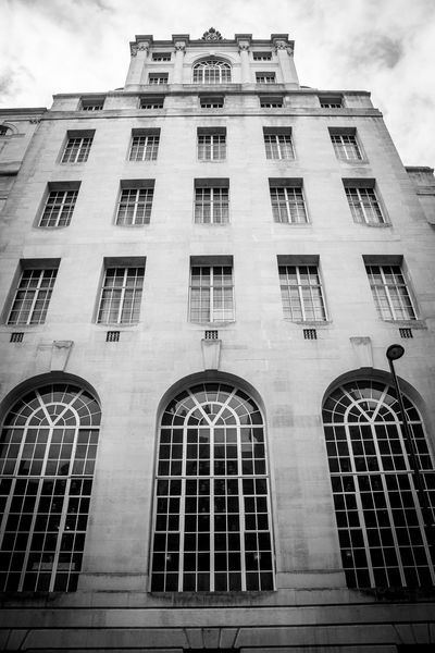 Building Exterior Architecture Low Angle View Built Structure Window Façade No People History Outdoors Business Finance And Industry Archival Travel Destinations Sky City Security Bar Day Blackandwhite Photography Black And White Lookingup Skyscrapers Skyscraper Blackandwhite Art Deco Architecture Art Deco