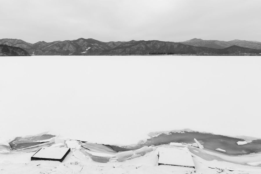 black and white image of snow-covered lake, Uiamho Lake in Chuncheon, Gangwondo, South Korea Black & White ChunCheon Cold Lake Cold Weather Gongjicheon Snow Land Uiamho Lake Winter Winter Landscape Black And White Blackandwhite Bw Cold Cold Temperature Day Mountain Nature No People Outdoors Sky Snow Snow-covered Snow-covered Lake Winter Lake Winter Land Winter Time