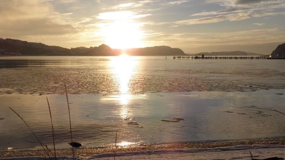 Water Sunset Sea Nature Reflection Sky Beauty In Nature Sand Scenics Beach Outdoors Cloud - Sky Tranquil Scene Tranquility No People Sunbeam Mountain Day Winter Snow Ice Iced Water Orange Sky Golden Hour Gold Sky Been There.