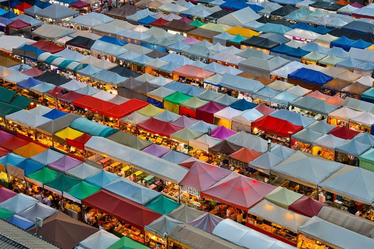 High angle view of multi colored tents at market