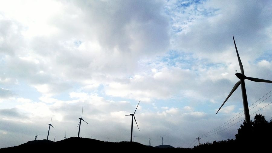 Alternative Energy Wind Power Wind Turbine Windmill Environmental Conservation Sky Renewable Energy Fuel And Power Generation Mountain Scenics Tranquil Scene Tranquility Environment Cloud Cloud - Sky Nature Day Solitude Outdoors Non-urban Scene