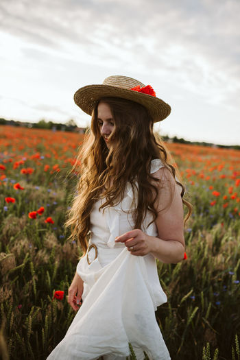 Beautiful woman standing on field