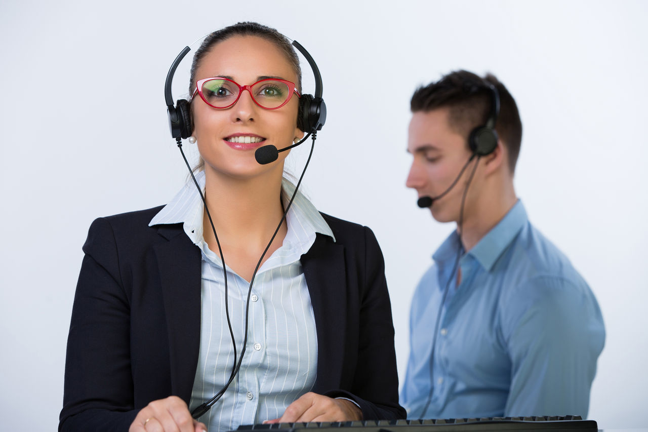 communication, using phone, technology, connection, headset, wireless technology, listening, service, young adult, telecommunications equipment, business, customer service representative, businesswoman, two people, young women, working, talking, indoors, well-dressed, answering, it support, call center, day, close-up