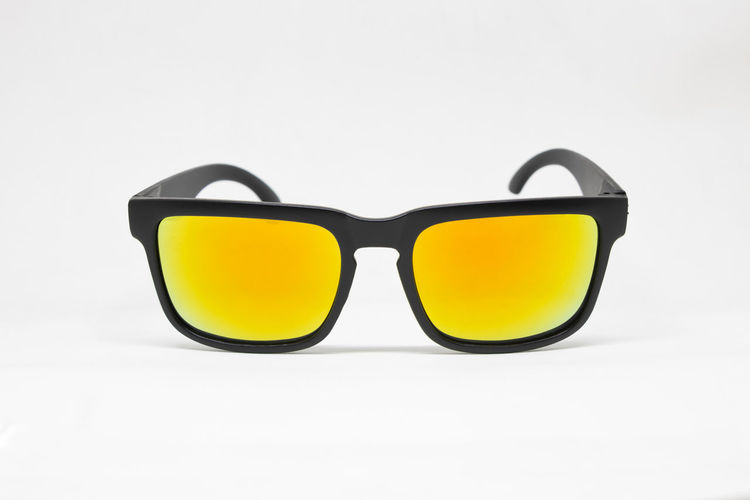Close-up of sunglasses against black background