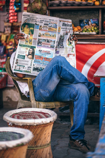 Newspaper Reading Adult Business Hands Newspapers Read Reading Break Chairs Close-up Communication Day Hold Hold Newspape Holding Leisure Activity Men News News Photography Newspaper Newspaper Reading One Person Outdoors People Person Real People
