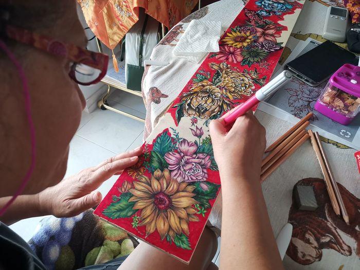 High angle view of woman drawing on cardboard