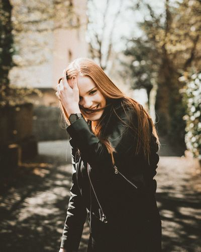 She just smiled Women Beautiful People Females Young Adult Beauty Street Long Hair Autumn Portable Information Device Smiling One Person Blond Hair Outdoors Beautiful Woman Only Women Young Women Portrait City Cheerful Happiness