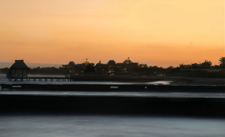 Architecture Beauty In Nature Building Exterior Built Structure Day Long Exposure Nature No People Orange Color Outdoors Scenics Sea Silhouette Sky Sunset Tranquility Travel Vacation Water Waterfront