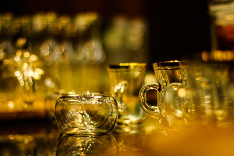 Food And Drink Glass - Material Transparent Drink Glass Refreshment Indoors  Selective Focus Table Drinking Glass Household Equipment Still Life Close-up No People Alcohol Focus On Foreground In A Row Wineglass Container Bar - Drink Establishment Bar Counter Crockery Luxury