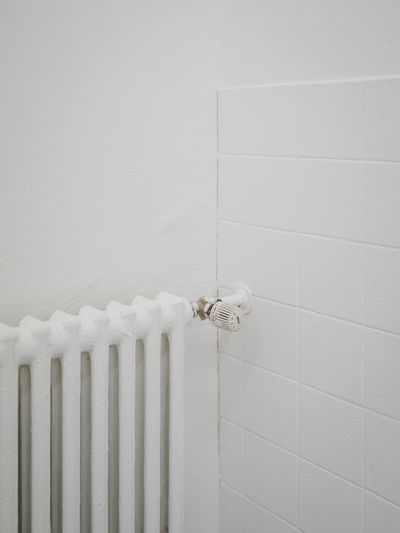 Close-up of white pipes on wall at home