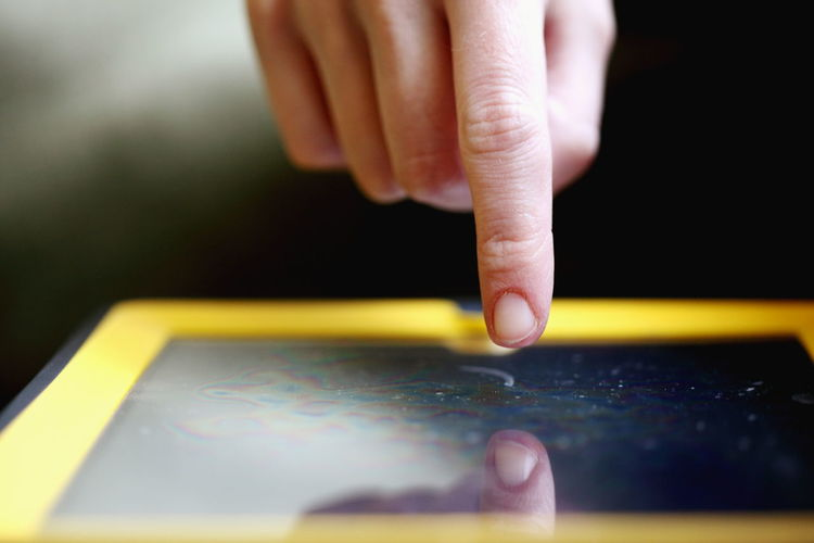 Close-up of using digital tablet