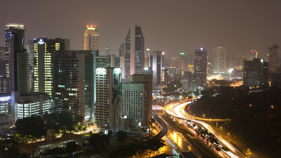 Illuminated cityscape seen from petronas towers at night